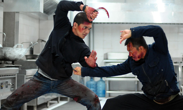 Iko Uwais and Cecep Arif Rahman duke it out in The Raid 2 (2014). Source: The Guardian