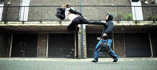 Zara Phythian fly-kicks an opponent in the short film, Kung Fu Darling (2016).