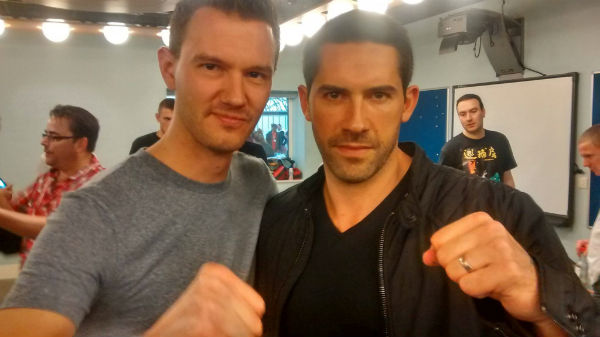 Kung Fu Movie Guide podcast host Ben Johnson with Scott Adkins at the 2014 Fighters Inc. SENI expo in London, UK.